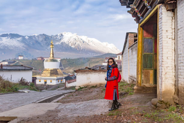 A woman standing in front of Langmu temple stock photo