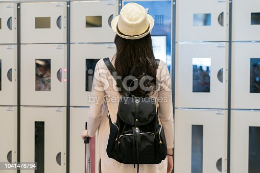 istock woman standing in front of lockers. 1041476794