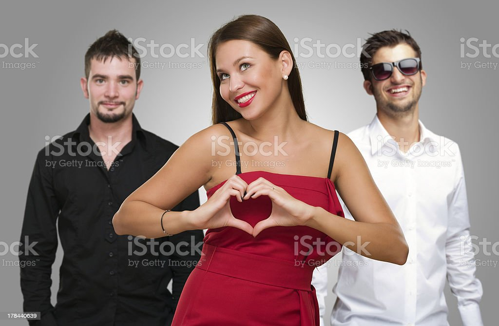 Woman Standing In Front Of Men stock photo