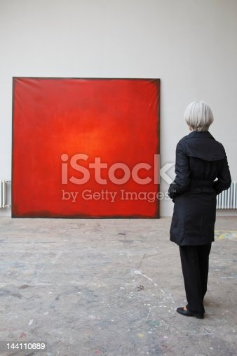 istock woman standing in front of red painting 144110689