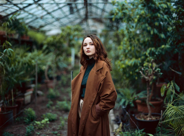 Woman standing in greenhouse stock photo