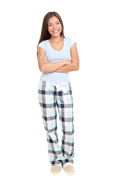 Woman standing in pajamas stock photo
