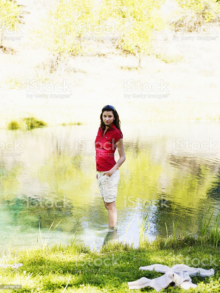 Woman standing in pond royalty-free stock photo