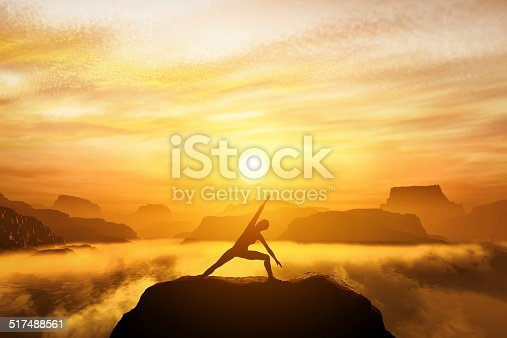 Woman standing in side angle yoga position, meditating on the top of mountains above clouds at sunset. Zen, meditation, peace