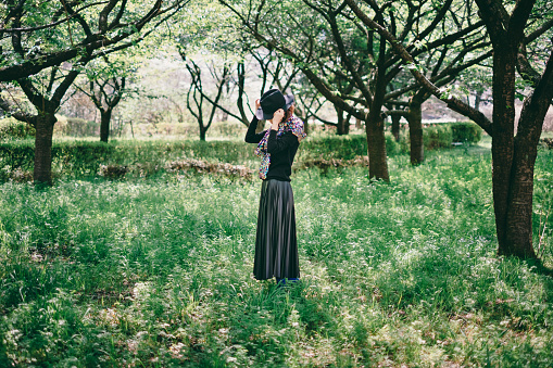 486439381 istock photo Woman standing in the forest 1220360716