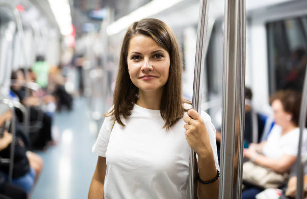 Woman standing in underground car stock photo