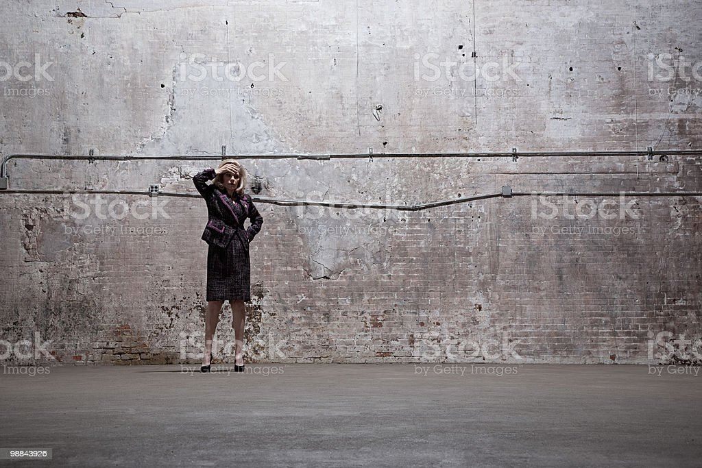 Woman standing in warehouse royalty free stockfoto