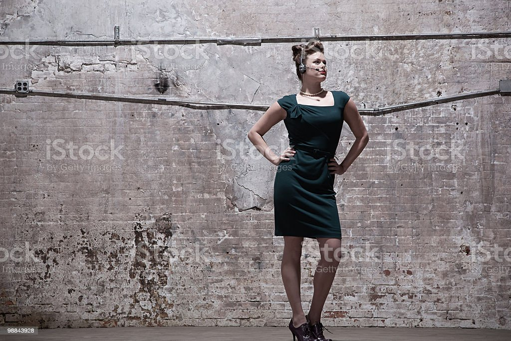 Woman standing in warehouse royalty-free 스톡 사진