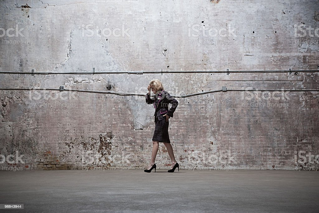 Woman standing in warehouse royalty-free stock photo
