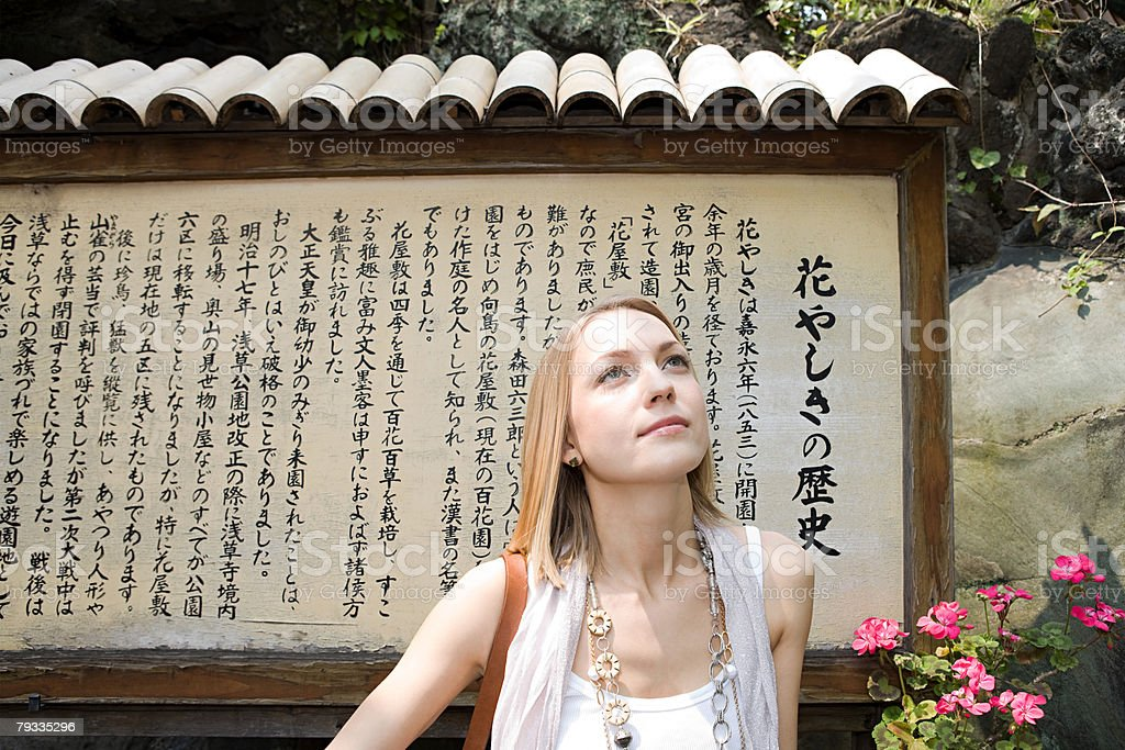 Woman standing near a japanese sign royalty-free 스톡 사진