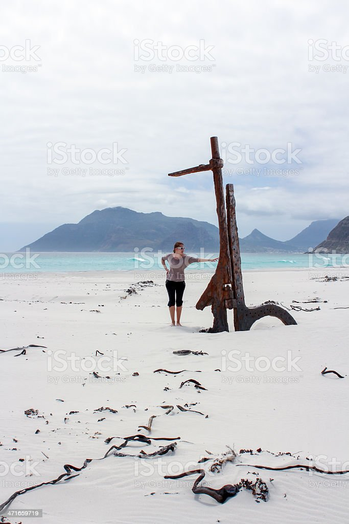 Woman standing near Shipwreck Kakapo at the beach of kommetjie royalty-free stock photo