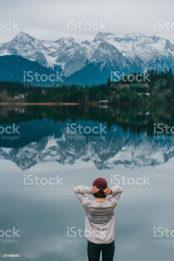 Woman standing  near the Eibsee lake in Alps stock photo
