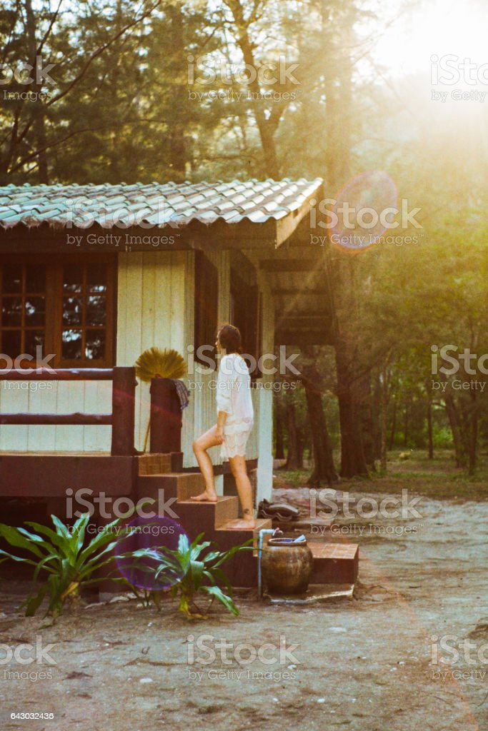 Woman standing near the house stock photo