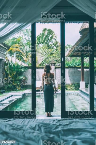 Woman standing near the swimming pool on villa picture id932093734?b=1&k=6&m=932093734&s=612x612&h=wbrdab8gfdybzwm35bduwa7xlie1hp  znkuldorncs=