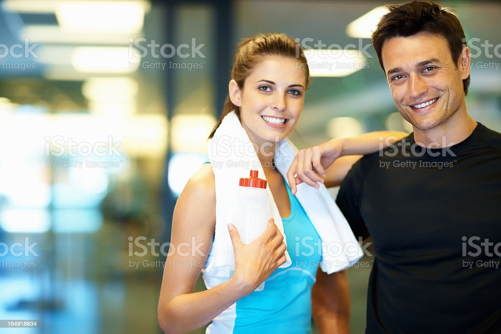 Woman standing next to her personal trainer royalty-free stock photo