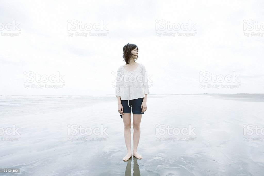 Woman standing on a beach royalty-free 스톡 사진
