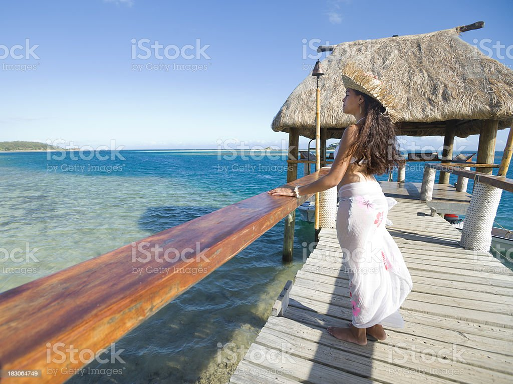 Woman standing on a Jetty tropical island royalty-free stock photo