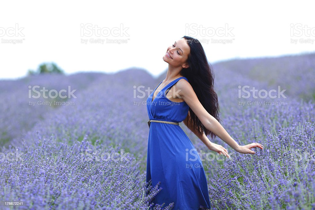 Woman standing on a lavender field royalty-free stock photo