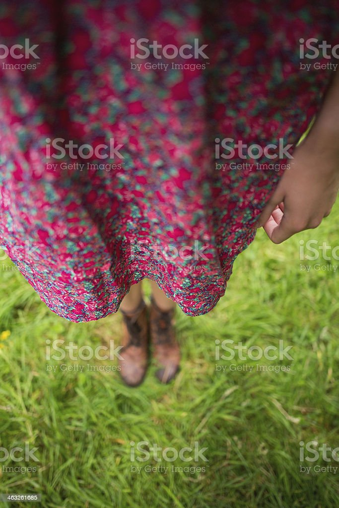 Woman standing on a meadow royalty-free stock photo