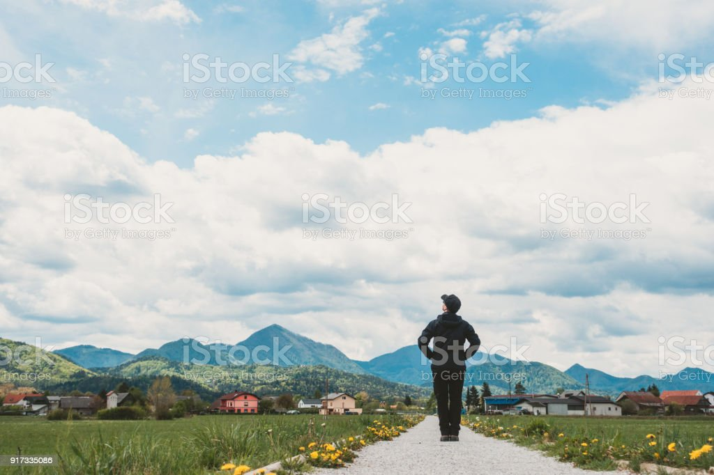 Woman standing on a spring path stock photo