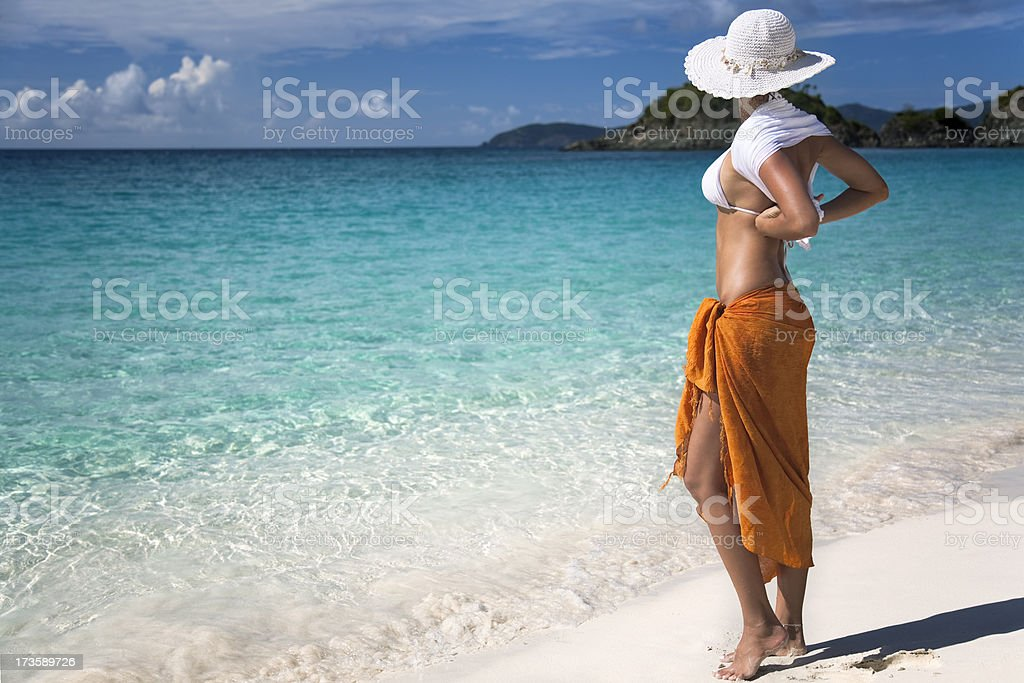 woman standing on a tropical beach in the Caribbean royalty-free stock photo