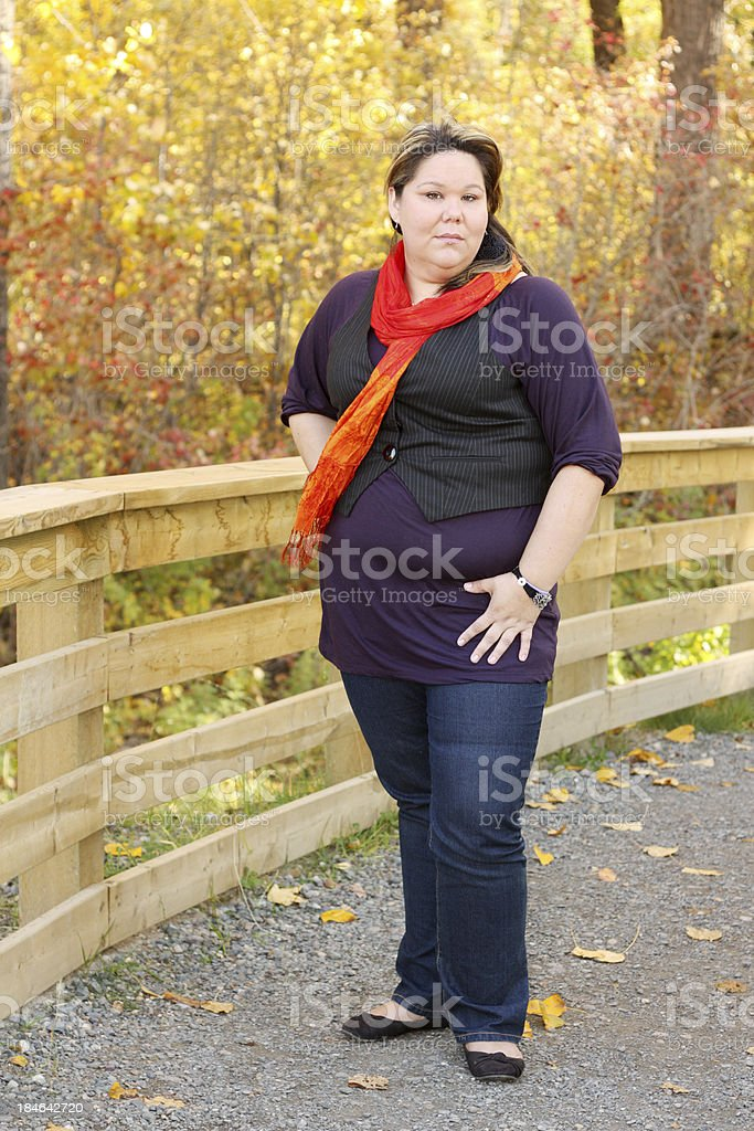 Woman Standing On A Walkway stock photo