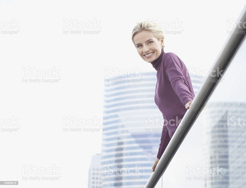 Woman standing on balcony outdoors royalty-free stock photo