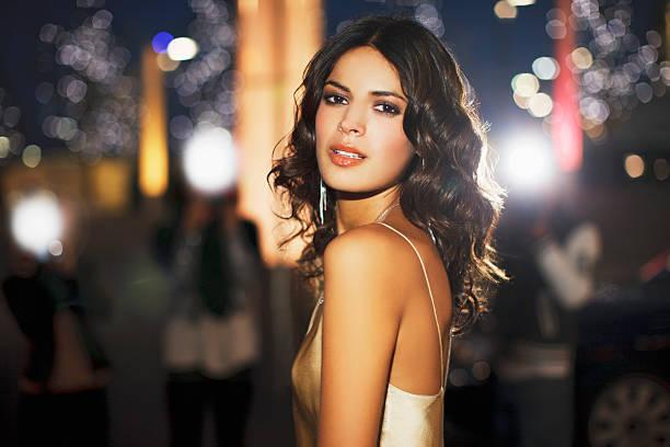Woman standing on city street at night picture id130406720?b=1&k=6&m=130406720&s=612x612&w=0&h=m05nddlfzloffbjauzsyvgv108kelhie i1ch9ebasc=