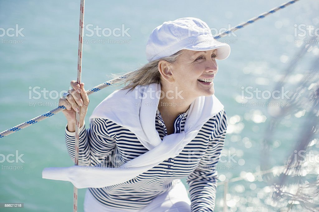 Woman standing on deck of boat royalty-free stock photo