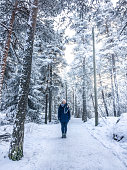 Young Woman Standing on Footpath in Park, Tempere, Finland