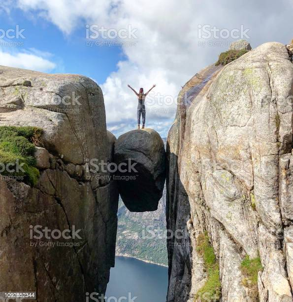 Photo of Woman standing on kjeragbolten