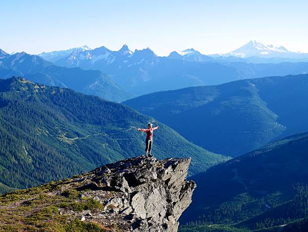 Woman Standing on  Mountain Top. – Foto