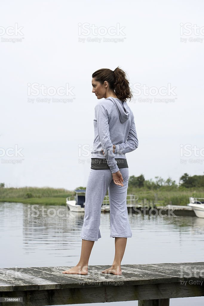 Woman standing on pier  30-34 Years Stock Photo