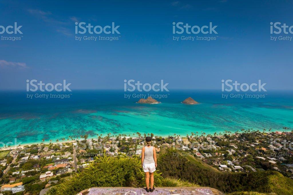 Woman standing on pillbox near Kailua. stock photo