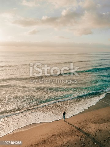 Lonely woman standing on the beach