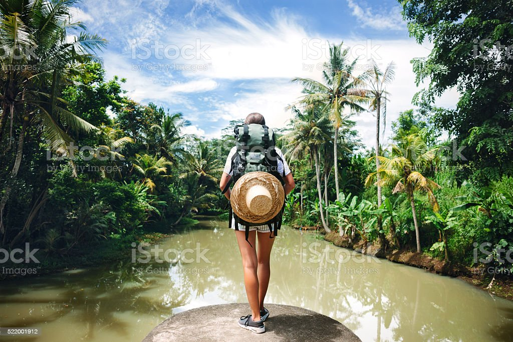 Woman standing on the edge and looking far away stock photo