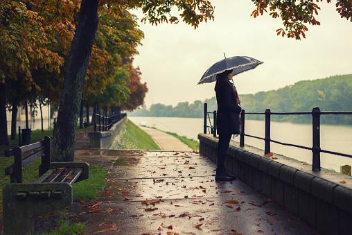 Woman standing on the rain