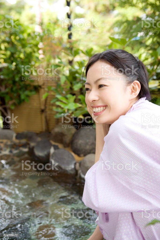 Woman standing on the side of the bath royalty-free stock photo