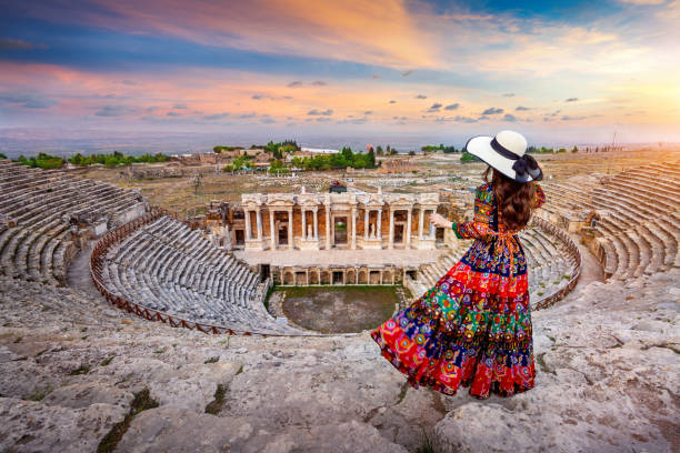 Woman standing on theater of Hierapolis ancient city in Pamukkale, Turkey. stock photo