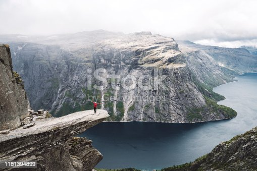 Trolltunga rock with a characteristic shape located in Norway on the border of the Hardangervidda plateau, close to the town Tyssedal. It is a popular tourist attraction in Norway and heavily visited by tourists during the summer months.
