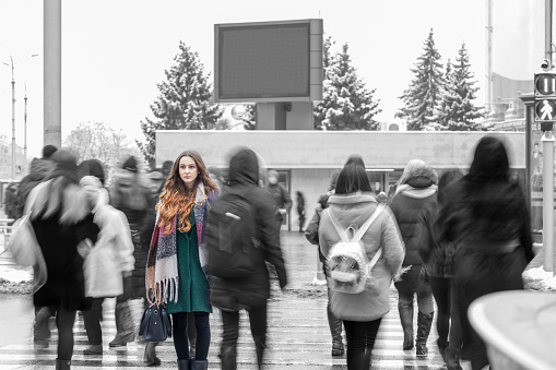 istock woman standing out from the crowd 1092691130
