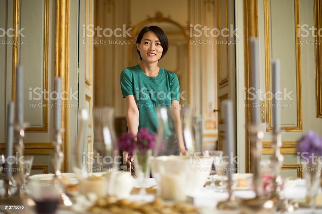 Woman standing proudly at her home stock photo