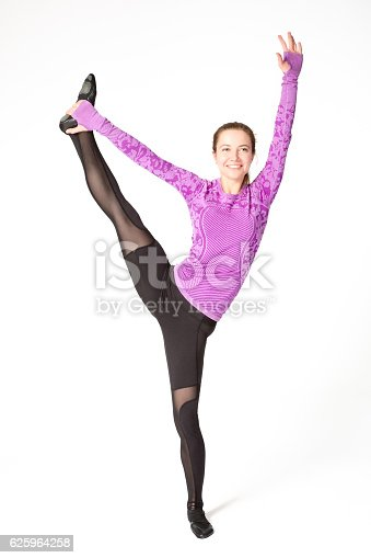 istock woman standing splits yoga pose with one leg raised up 625964258