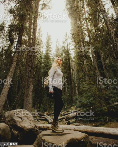 Photo of Woman standing strong in a forest