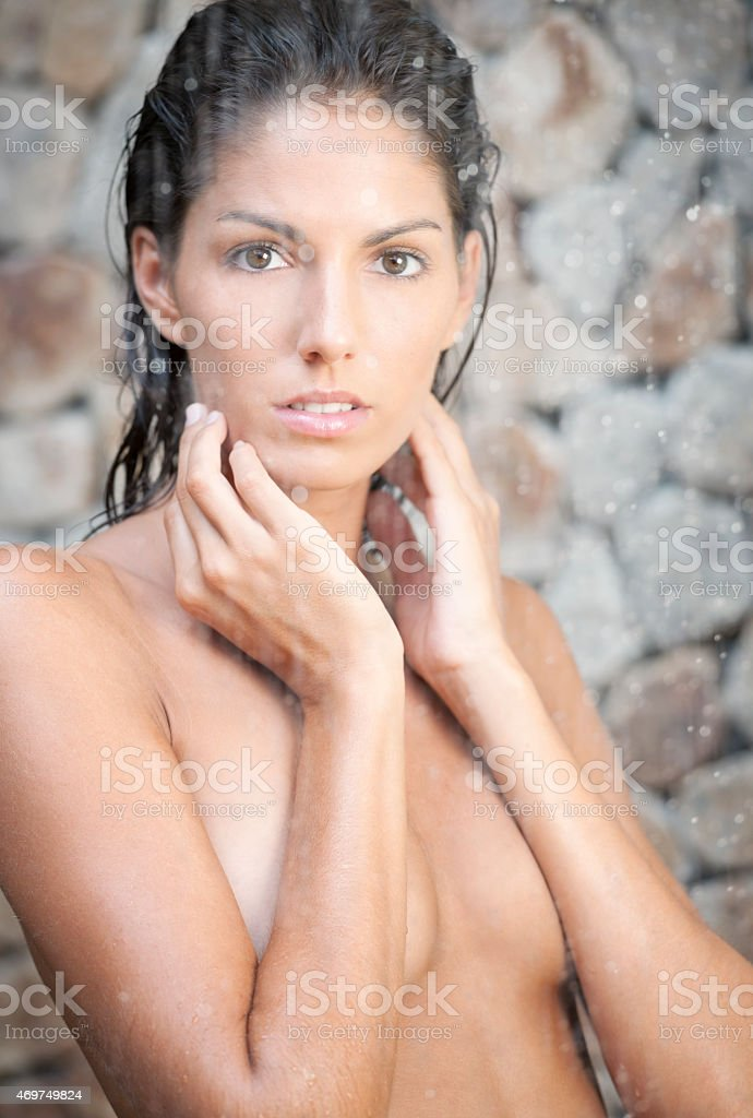 Woman standing under a tropical Rain Shower in Spa royalty free stock  photo Standing Under A Tropical In Stock Photo