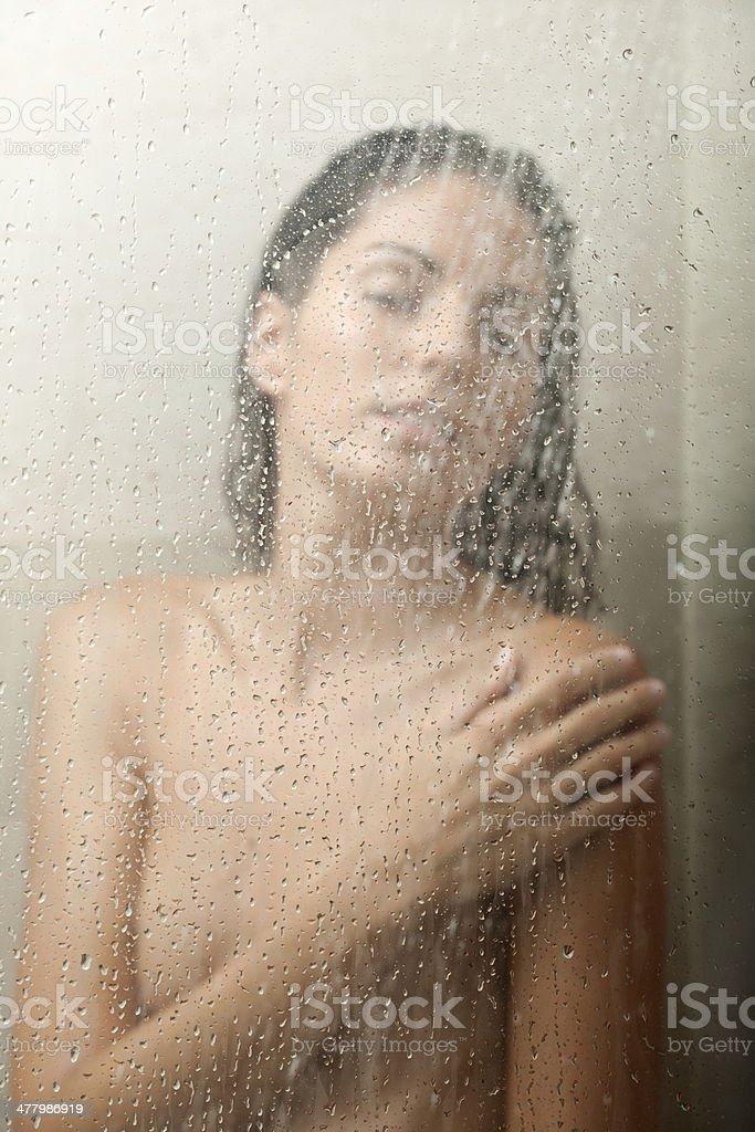 Woman standing under the Shower, Relaxing royalty-free stock photo