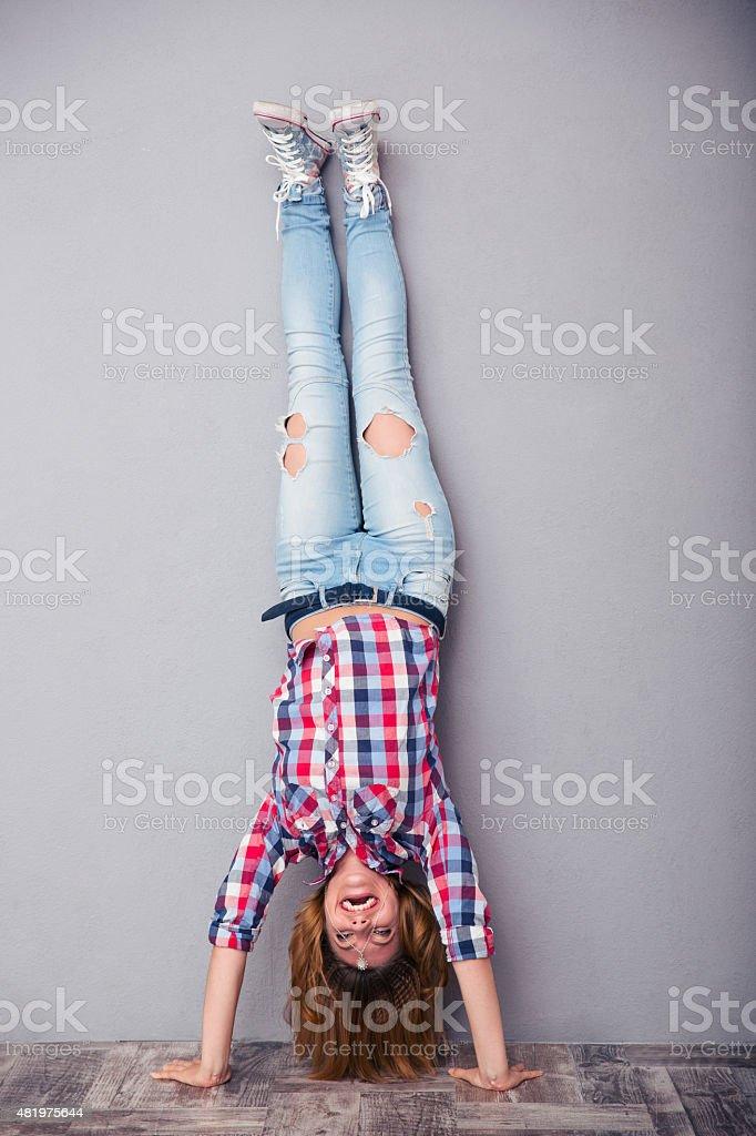 Woman standing upside down stock photo
