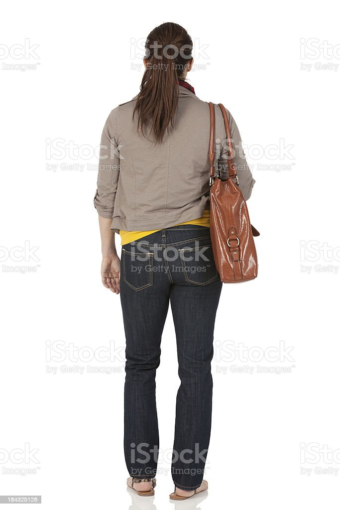Woman standing with a bag royalty-free stock photo