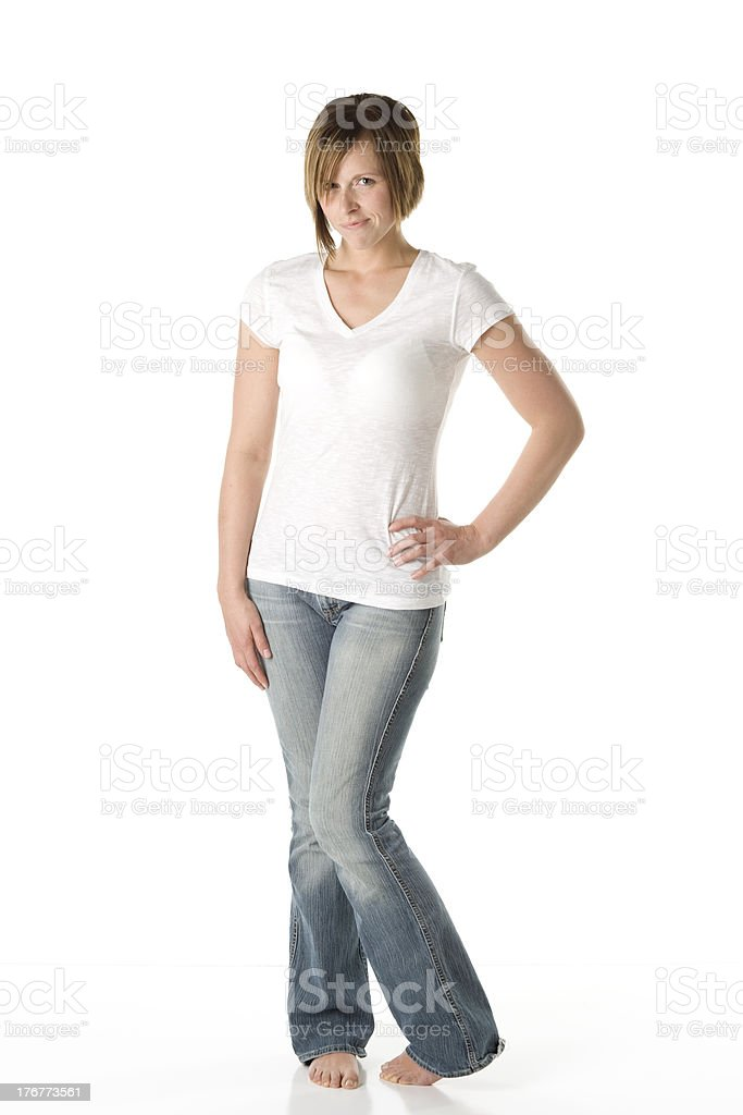 Woman Standing with a Shy Expression stock photo