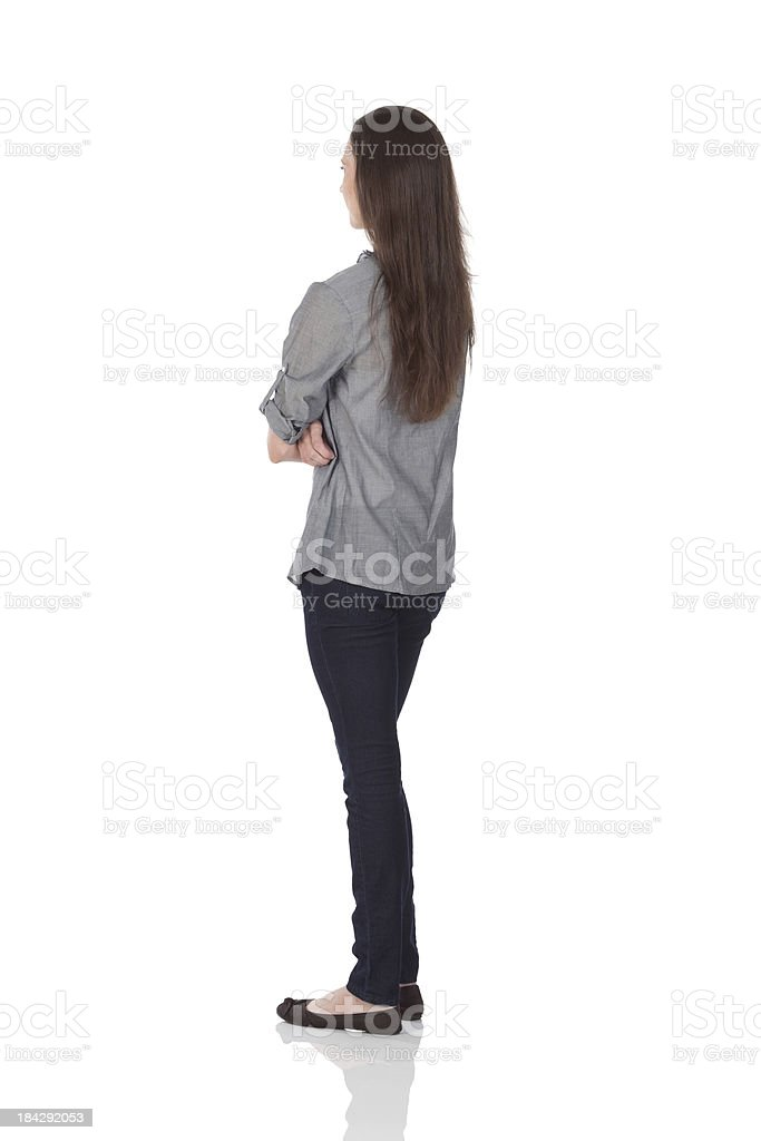 woman standing with arms crossed stock photo